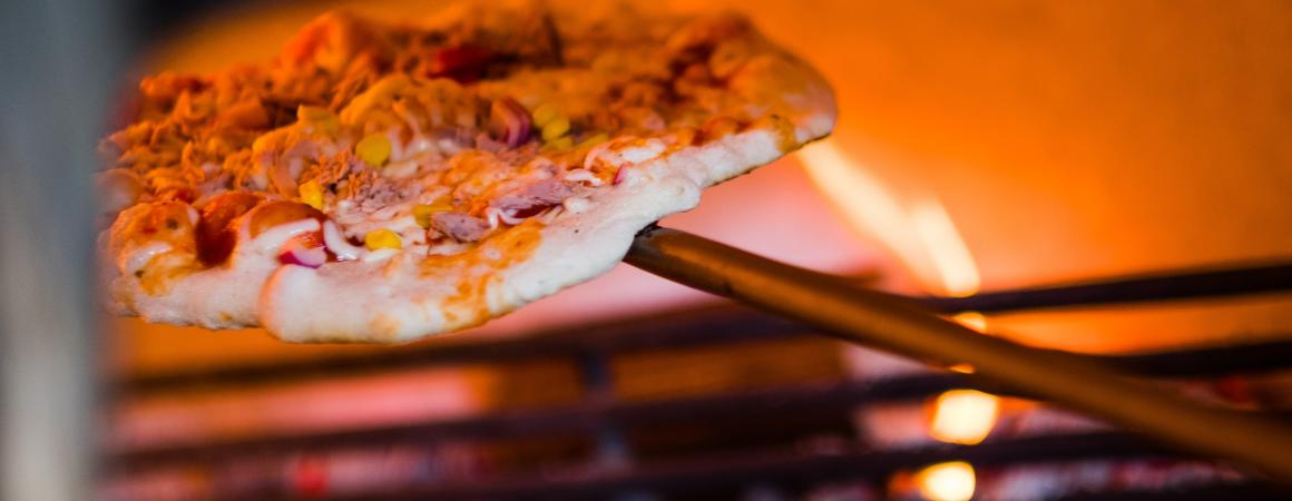 Delicious pizza form our wood fired oven